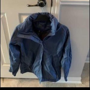 New without tag Stormtech blue jacket.